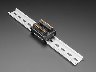 Angled shot of DIN Rail 10x10 to Terminal Block Adapter on a DIN rail.