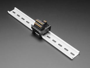Angled shot of DIN Rail 6x6 to Terminal Block Adapter on a DIN rail.