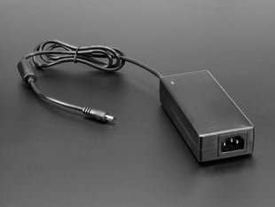 5V 10A switching power supply brick with IEC power port.