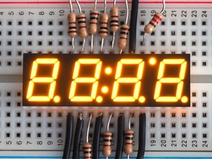 Yellow 7-segment clock display - 0.39