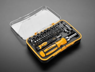Open case of screwdriver kit with two handles and many tips and sockets
