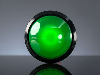 Head-on shot of massive 100mm green arcade button.