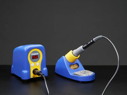 Two piece adjustable soldering iron with blobby temperature adjustable body and separate fancy holder
