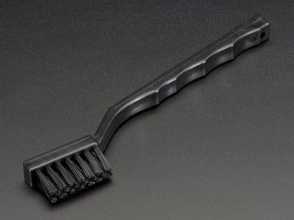 Black toothbrush-looking brush