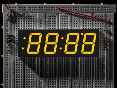 Huge yellow 7-segment clock display with all segments lit