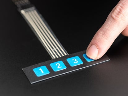 Finger pressing a button of 1x4 flexible  keypad