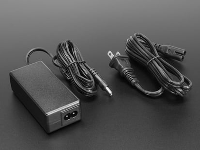 5V 4A switching power supply brick with figure 8 power port.