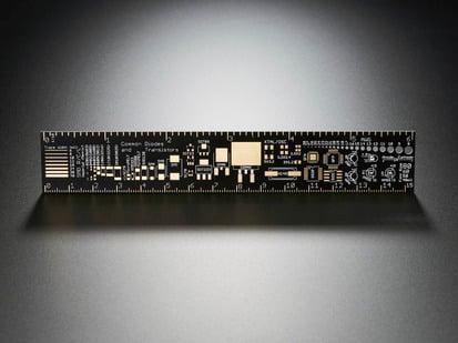 Dramatically lit Adafruit PCB Ruler