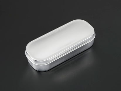 Small hinged mint tin case, closed.