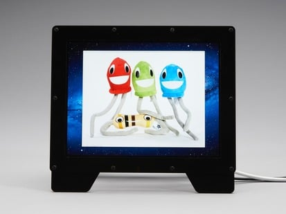 Adafruit Qualia 9.7 inch DisplayPort Monitor on table showing an image of LED puppets