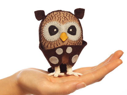 Hand holding finished Sew-Your-Own Owl Kit