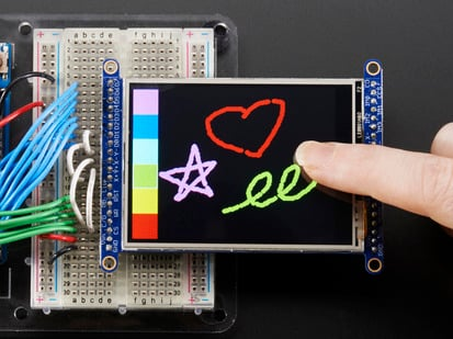 TFT breakout wired to arduino, hand drawing a heart using touchscreen
