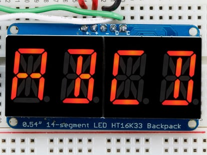 "Assembled Quad Alphanumeric Display with red display showing ""ABCD"""