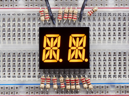 Yellow Dual Alphanumeric Display module wired to breadboard, all segments lit