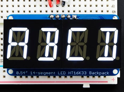 "Assembled Quad Alphanumeric Display with white display showing ""ABCD"""
