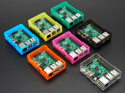 Angled shot of several assembled Model B+ / Pi 2 / Pi 3 cases all in different colors.