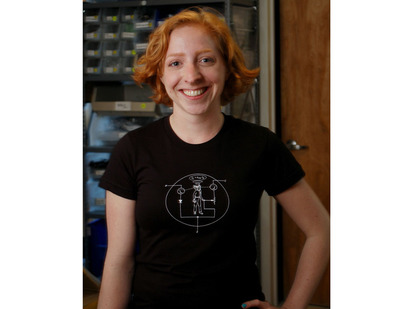 Women wearing black t-shirt with white NPN transistor diagram with a man inside the diagram