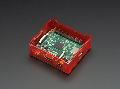 Angled shot of red Raspberry Pi Model A+ Case without lid.
