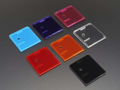 Angled shot of group of variously colored lid covers for Raspberry Pi Model A+ Cases.