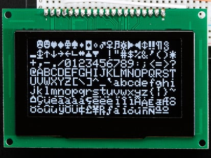 Monochrome 2.7 128x64 OLED Graphic Display Module showing white text