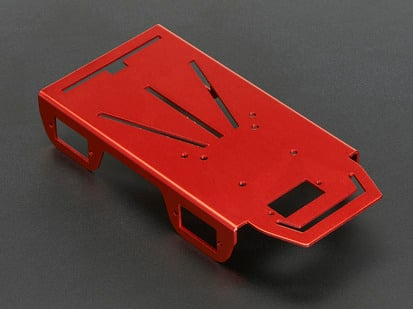 Red bent-sheet robot chassis showing various holes and slots.