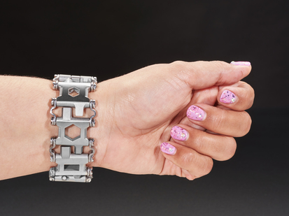 Wrist with chunky metal bracelet