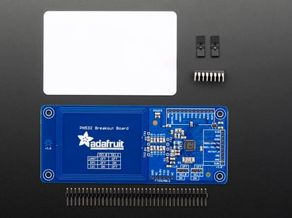 PN532 NFC/RFID controller breakout board with header, chip and white card