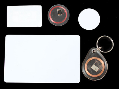 Assortment of discs, cards and stickers with RFID copper coils inside