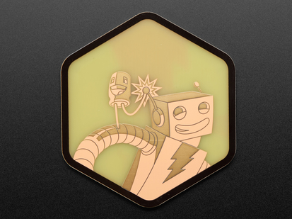 A PCB coaster featuring a friendly robot, AdaBot, and a friendly LED character.