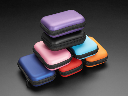 Many zipper cases in colors piled up