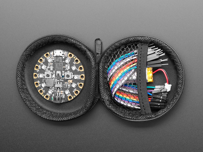 opened Round Black Zipper Case with circuit playground and components