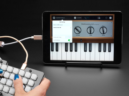 Adapter cable connecting NeoTrellis sequencer to iPad