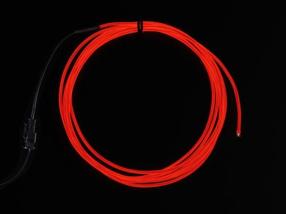 Coil of lit EL wire in red