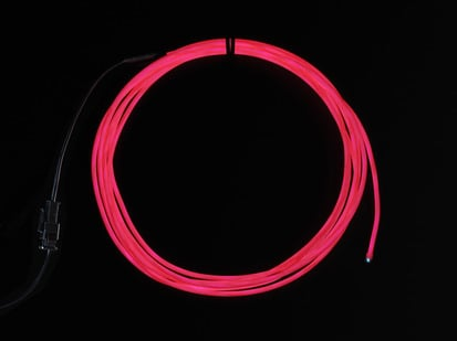 Coil of lit EL wire in pink