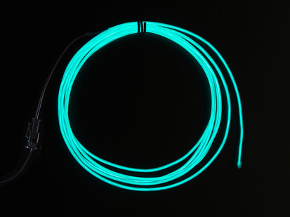Coil of lit EL wire in aqua