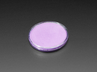 Angled shot of round purple disc of fluorescent paint.