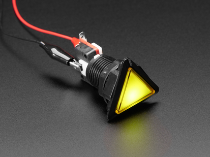Angled shot of a yellow triangle illuminated LED pushbutton.