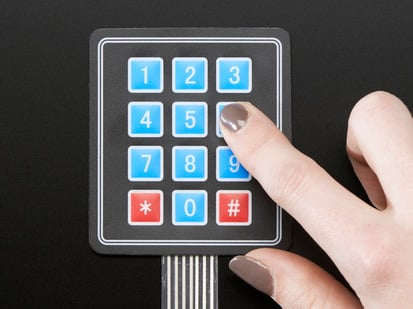 Finger pressing one key of 3x4 keypad