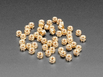 pile of 50 Brass Heat-Set Inserts for Plastic