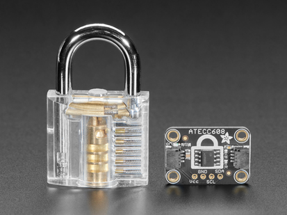 Adafruit ATECC608 Breakout Board  next to clear padlock