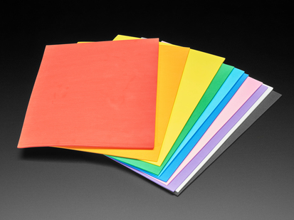 Angled shot of rainbow-colored EVA foam sheet packed fanned out.