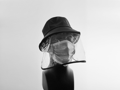Black bucket style hat with a clear vinyl face mask attached, shown on a mannequin