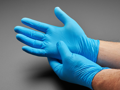 Blue nitrile gloves show being worn
