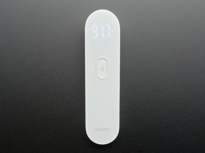 White no touch thermometer shown laying flat and displaying a temperature