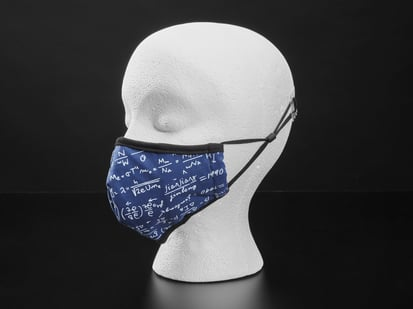Blue cloth face mask with math equations written in white shown on a mannequin