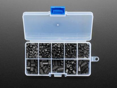 Opened box showing many nylon screws