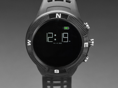 Close up of the watch face powered on and displaying the time