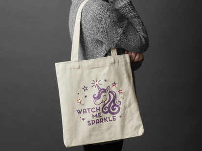 Person with completed DIY Watch Me Sparkle Light-Up Tote Bag Kit slung over sholder