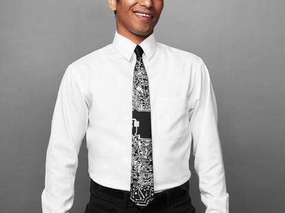 Man wearing black tie with silver circuit board imagery