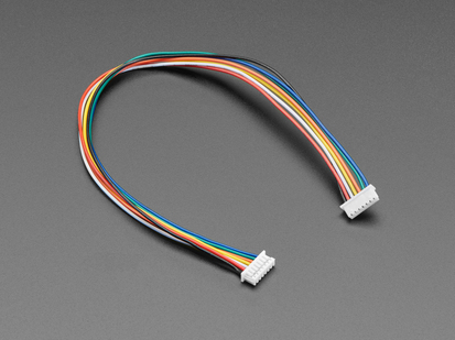 Angled shot of 20cm long 1.25mm pitch 7-pin color-coded cable.